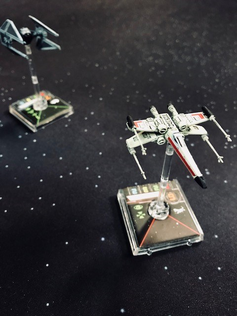 An X-Wing dogfight